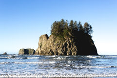 Pacific Northwest Rocky Islands. A cluster of small islands off the coast of Washington. Small waves lap the shoreline Stock Image