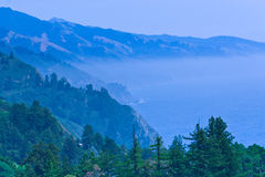 Pacific ocean bay in a blue fog mist. Royalty Free Stock Photos