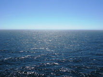 Pacific ocean with clear horizon, bright sunshine, reflections on choppy water Royalty Free Stock Photography
