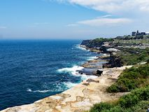 Pacific Ocean Cliffs, Bronte, Sydney, Australia. View over the Pacific Ocean and Bronte cliffs, Sydney, NSW, Australia, and view to the historic Waverley stock images