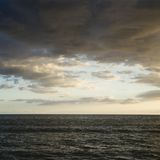 Pacific ocean and cloudy sky. Royalty Free Stock Image