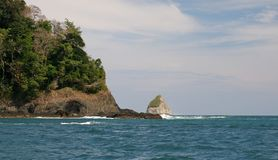 Pacific ocean and coast line. View of the Pacific ocean on the coast of Costa Rica with trees in foreground Stock Images