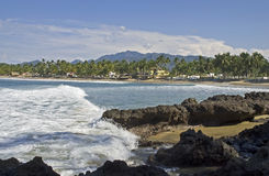 Pacific Ocean cove and beach in Nayarit, Mexico. Gentle ocean surf rolling onto the beach in Lo de Marcos, Nayarit, Mexico Stock Image