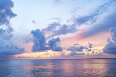 Pacific ocean in Cozumel. Beautiful cloudy sunset at the summer beach of the ocean. Vacation. Meditation. Soft colors Royalty Free Stock Photography