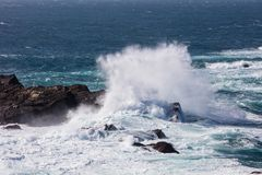 Waves Crash on Rocky California Coastline Stock Image