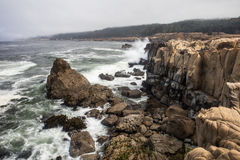Pacific Ocean Crashing on Rocky California Coast Royalty Free Stock Images