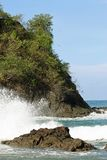Pacific ocean and crashing waves. View of the Pacific ocean with waves crashing on rocks on the coast of Costa Rica Stock Photo
