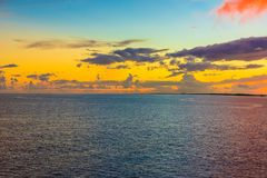 The Pacific Ocean at Dusk as the Sun Falls below the Horizon. Sweeping photo looking over the  blue waters of the Pacific as the sun sinks below the horizon stock photo