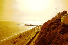 The Pacific Ocean and `The Green Coast` under a Mighty Sun, Lima - Peru royalty free stock photos