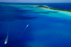 Pacific Ocean Island. Aerial view of boats at tropical Pacific Island Royalty Free Stock Photography