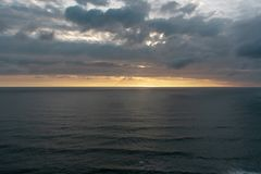 Pacific Ocean January sunset stock images