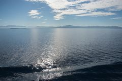 Pacific Ocean: Morning Light. Morning scenic view with mist over the Pacific Ocean and South Pacific Island of Fiji with a blue sky and rippling water stock photos