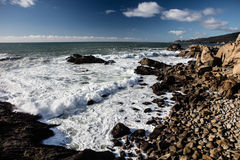 Pacific Ocean and Northern California Coastline. Waves from the Pacific Ocean wash against the dramatic coastline of northern California. This scenic area just Royalty Free Stock Photo