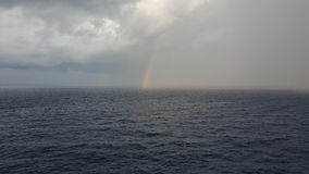 Pacific Ocean Rainbows. Cruise balcony view of a rainbow over water Stock Image