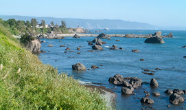 Pacific Ocean Shore line near Crescent City California. Blue water and blue sky Royalty Free Stock Photos