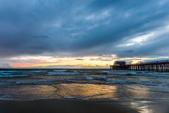 Pacific ocean during sunset and pier Royalty Free Stock Photography