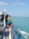 Pacific ocean, Thailand - October 25, 2013: Passenger ship in open ocean with people on deck Stock Image