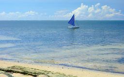 Pacific Ocean. A view of the Pacific Ocean with a sailboat. Siargao Island, Philippines stock photos