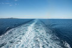 Pacific Ocean Wake: Fiji. Morning scenic view over the Pacific Ocean and South Pacific Island of Fiji with a blue sky and cruise ship wake royalty free stock image