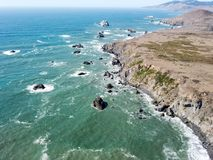 Aerial View of Sonoma Coast in California. The Pacific Ocean washes against the rocky coastline in Sonoma, California. The famous Highway 1 runs along this royalty free stock image