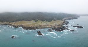 Aerial View of Marine Layer and Coastline of Northern California in Sonoma. The Pacific Ocean washes against the wild, rocky coast of northern California. This stock image
