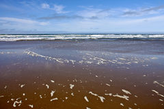 Pacific Ocean water and beach. Royalty Free Stock Image