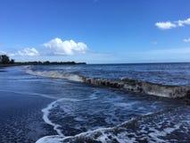 Pacific Ocean Waves with Dirt from Waimea River from Waimea Canyon at Waimea Beach on Kauai Island in Hawaii. Stock Photo