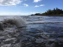 Pacific Ocean Waves with Dirt from Waimea River at Waimea Beach on Kauai Island in Hawaii. Stock Images