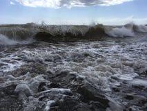 Pacific Ocean Waves with Dirt from Waimea River at Waimea Beach on Kauai Island in Hawaii. Stock Photos