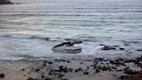Pacific Ocean Waves on Rocks. At South Bondi Beach, Sydney, Australia, late Summer afternoon Royalty Free Stock Photo
