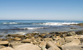 Pacific Ocean waves and rocky shoreline Royalty Free Stock Photos