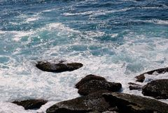 Pacific Ocean Waves Swirling Around Coastal Rocks, Australia Royalty Free Stock Photos