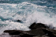 Pacific Ocean Waves Swirling Around Coastal Rocks, Australia Royalty Free Stock Image