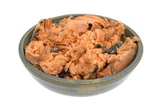 Pacific pink salmon in an bowl on a white background. Pacific canned pink salmon in an old stoneware bowl isolated on a white background Stock Images