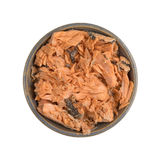 Pacific pink salmon in an bowl on a white background. Top view of Pacific canned pink salmon in an old stoneware bowl isolated on a white background Royalty Free Stock Photo