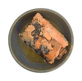Pacific pink salmon in an bowl on a white background. Top view of canned Pacific pink salmon in an old stoneware bowl isolated on a white background Stock Photo