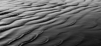 Pacific Sandscape. Pacific ocean washing over sand Royalty Free Stock Image