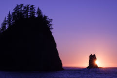 Pacific Sun. Beautiful sunset on Washington's coast behind the protruding rock formations Royalty Free Stock Images