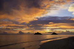 Pacific sunrise at lanikai beach. In hawaii with the mokulua islands on the horizon Stock Photo