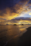 Pacific sunrise at lanikai beach. In hawaii with the mokulua islands on the horizon Royalty Free Stock Photo