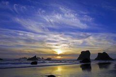 Pacific Sunset. Ocean view of a Pacific Sunset with rock and sand in the foreground Stock Image