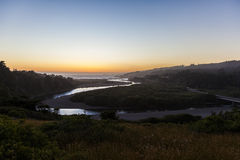 Pacific sunset. Landscape of river empting into pacific at sunset Stock Photos