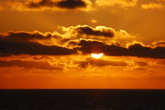 Pacific Sunset. Sun setting over the Pacific Ocean royalty free stock image