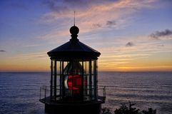 Pacific Sunset Behind Cape Mears Light Stock Photo