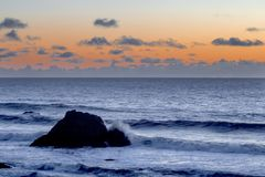 Pacific Sunset. The light from the setting sun casts a soft light on clouds over the Pacific Ocean at California`s central coast royalty free stock photography