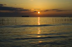 Pacific Sunset. Sunset over Pacific Ocean with big ship Royalty Free Stock Photos