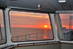 Pacific sunset through porthole  Royalty Free Stock Photography
