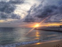 Pacific Sunset. Sunsetting on Waikiki Beach Walk Royalty Free Stock Images