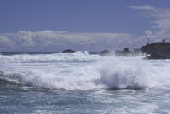 Pacific Waves. View of waves breaking at remote Easter Islands coast on a clear sunny day Stock Photography