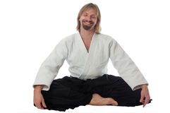 Pacification teacher of aikido sit and smile Royalty Free Stock Photos